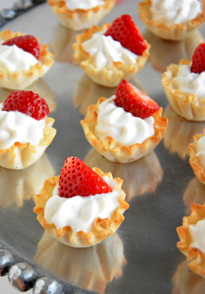 {5 Ingredient} Strawberries and Cream Tarts | A guilt free, no bake dessert with vanilla greek yogurt custard, phyllo cups & strawberries!