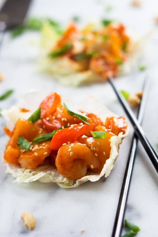 A healthy takeover make over! Skinny Sweet and Sour Shrimp Lettuce Wraps are full of Asian flavors, lighter and ready quicker than you can call take out!